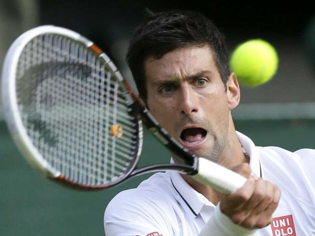 Top seed Djokovic beats Haas to enter Wimbledon quarter-finals
