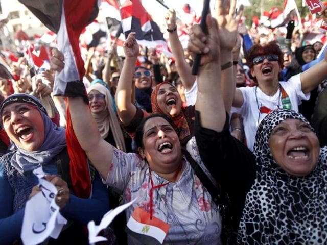 Egyptian-women-shout-slogans-against-president-Mohammed-Morsi-as-they-join-hundreds-of-thousands-demonstrating-outside-the-Egyptian-presidential-palace-in-Cairo-Egypt-AFP-Photo