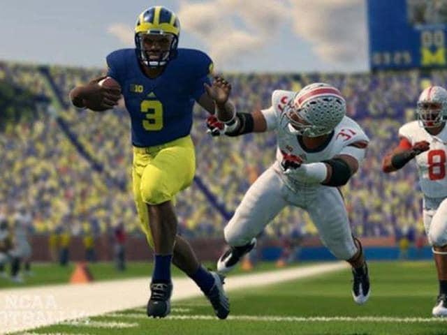 Denard-Robinson-L-is-the-NCAA-Football-14-cover-athlete-Photo-AFP