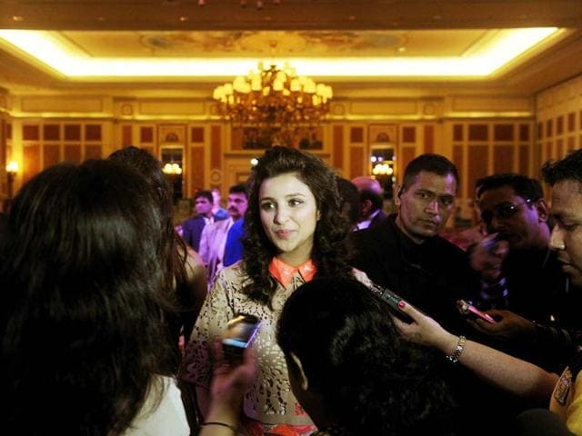 Parineeti Chopra speaks with the media after the opening press conference of the 14th IIFA at The Venetian hotel in Macau on July 4, 2013. (AFP Photo)
