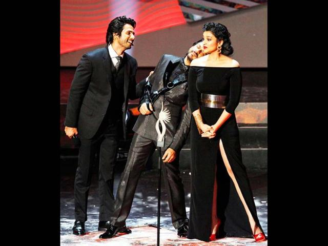 Playing to the gallery: Shahid Kapoor, Shah Rukh Khan and Parineeti Chopra entertain the IIFA audience with their gimmicks.