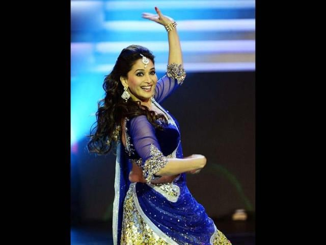Still the stunner: Radiant Madhuri Dixit lights up the stage with her performance at the IIFA awards.