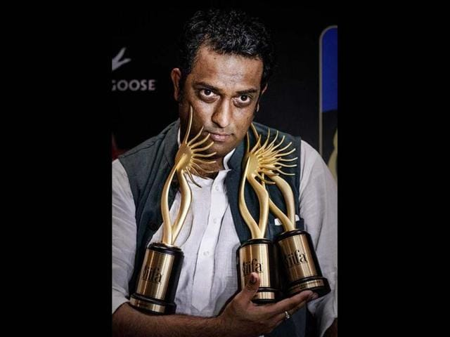 Got his hands full! Director Anurag Basu holds the best director, best actor (on behalf of absent Ranbir Kapoor) and the best story trophies for his film Barfi!