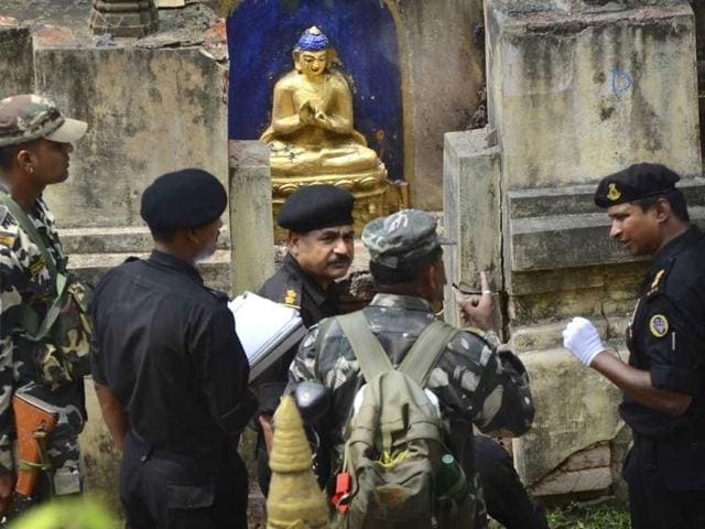 National-security-guards-inspect-the-site--a-day-after-the--serial-blasts-in-Mahabodhi-Temple-in-Bodh-Gaya-AP-Photo