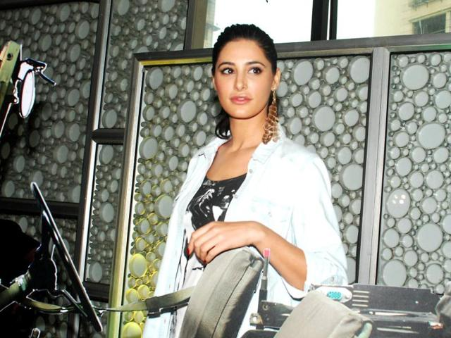 Nargis-Fakhri-and-John-Abraham-look-awesome-together-in-the-trailer-and-also-in-real-life-The-two-look-comfortable-in-each-other-s-company-during-Madras-Cafe-event-AFP-Photo