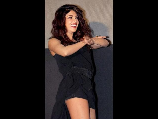 Priyanka Chopra demonstrates a step from her song Exotic at the launch. Wait... are her rompers revealing more than intended? That