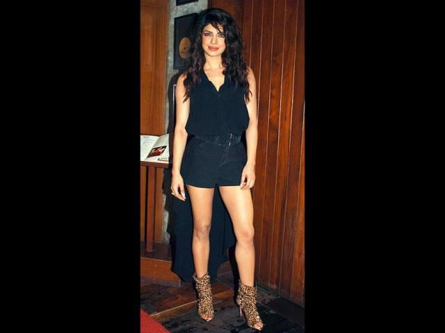 Priyanka Chopra looked a diva as she launched her latest song Exotic in Mumbai. Check out the rockstar at the event. (AFP PHOTO)