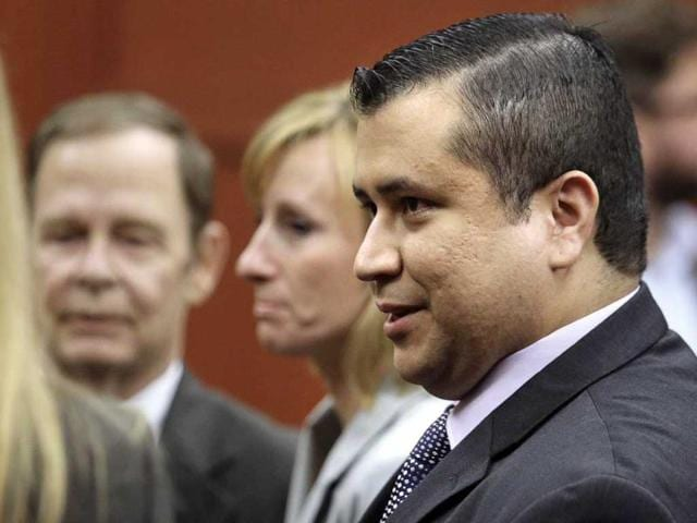 George-Zimmerman-leaves-court-with-his-family-after-Zimmerman-s-not-guilty-verdict-in-the-Trayvon-Martin-shooting-case-was-read-in-Seminole-Circuit-Court-in-Sanford-Florida-AP-Photo