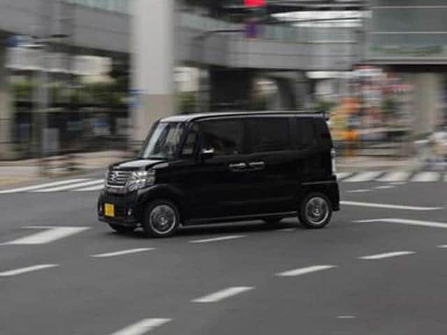 Honda-Motor-Co-s-N-Box-minicar-goes-on-a-street-in-Tokyo-July-13-2013-Picture-taken-July-13-2013-Photo-Reuters-Toru-Hana