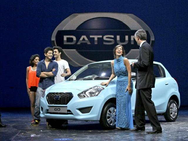 Vincent Cobee, corporate vice president, Datsun Business Unit, Nissan Motor Co. (right) talks to artists during the global launch of Datsun Go in New Delhi.(AP Photo)