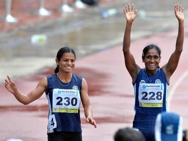 Women-s-200-meters-respective-silver-and-bronze-medal-winners-from-India-Asha-Roy-R-and-Dutee-Chand-wave-to-the-crowd-after-their-race-on-the-fifth-and-the-final-day-of-the-Asian-Athletics-Championship-2013-at-the-Chatrapati-Shivaji-Stadium-in-Pune-AFP-Photo
