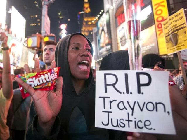 Protester Keisha Martin-Hall holds a bag of Skittles as she participates in a rally in response to the acquittal of George Zimmerman in the Trayvon Martin trial at Times Square. (Reuters Photo)