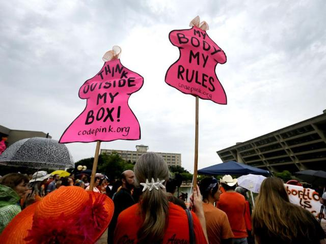 A-crowd-of-nearly-200-stand-in-front-of-the-city-hall-listening-to-speakers-at-a-rally-to-protest-the-approval-of-sweeping-new-restrictions-on-abortion-in-Dallas-Texas-AP-Photo