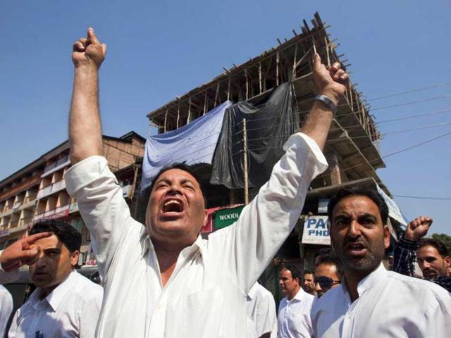 Kashmiri lawyers shout slogans during a protest against the killing of villagers by Border Security Forces in Srinagar. (AP Photo)