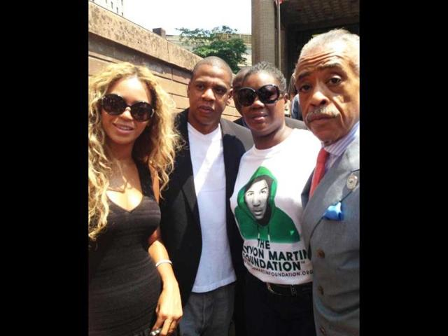 Beyonce-L-and-Jay-Z-second-left-join-Trayvon-Martin-s-mother-Sybrina-Fulton-second-right-and-reverend-Al-Sharpton-at-the-Justice-for-Travon-vigil-in-New-York-AP-Photo-Noerdlinger-Media