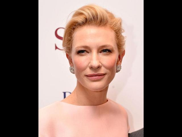 Known-for-her-sophisticated-style-statements-Cate-Blanchett-donned-a-fitted-Alexander-McQueen-gown-at-the-BAFTAs-with-silver-floral-detail-and-a-pendant-