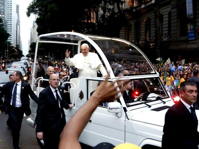 A-crowd-of-faithful-cheer-as-Pope-Francis-rides-in-his-popemobile-in-Rio-de-Janeiro-Brazil-AP-photo