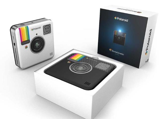 The-digital-camera-that-can-share-snaps-in-the-real-and-in-the-virtual-world-will-launch-in-early-2014-Photo-AFP