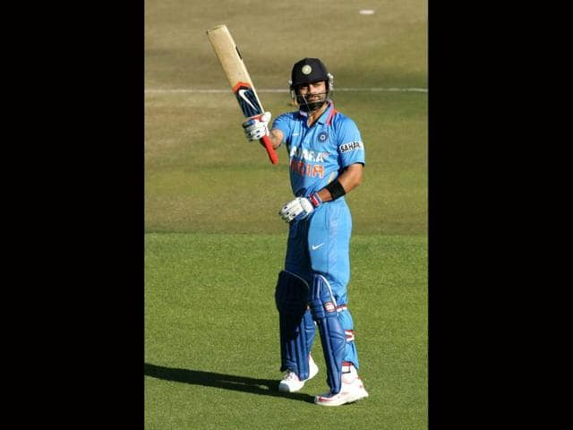 Virat-Kohli-raises-his-bat-after-scoring-his-century-AFP-Photo