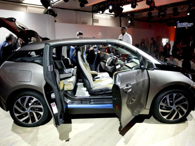 Members of the media inspect the new BMW i3 all-electric car at an unveiling event in New York. Reuters photo