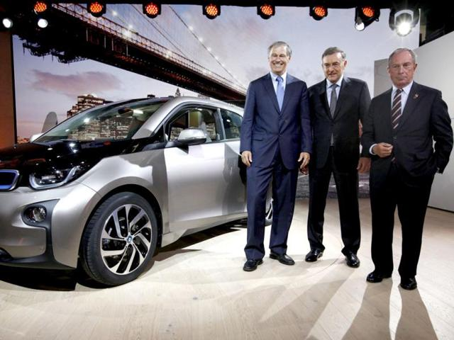 BMW CEO Norbert Reithofer (C) poses with New York City Mayor Michael Bloomberg (R) and Governor of Washington State Jay Inslee next to the new BMW i3 all-electric car at an unveiling event in New York. Reuters photo