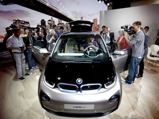 Members of the media inspect the new BMW i3 all-electric car at an unveiling event for the vehicle in New York. Reuters photo