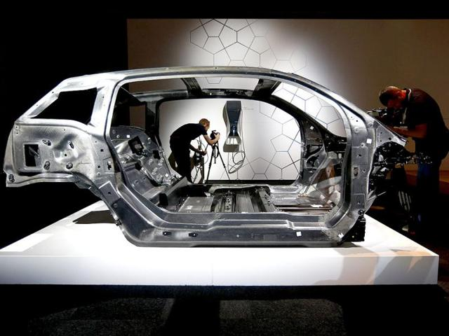 Cameramen work around the carbon fibre chassis for BMW's new i3 electric before it was unveiled in London. Reuters photo