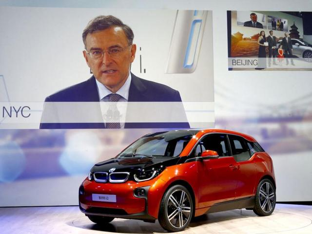 BMW's CEO Norbert Reithofer speaks via video link from New York as the new BMW i3 electric car is unveiled at one of three ceremonies worldwide, in London. Reuters photo