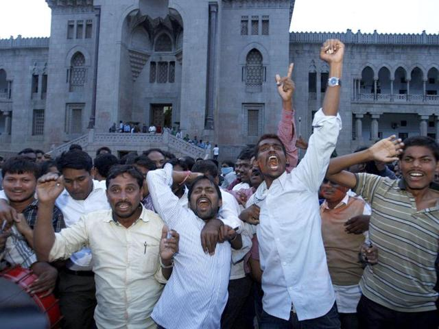 Students of Osmania University celebrate after UPA endorsed the creation of a new state Telangana in Hyderabad. (AP Photo)