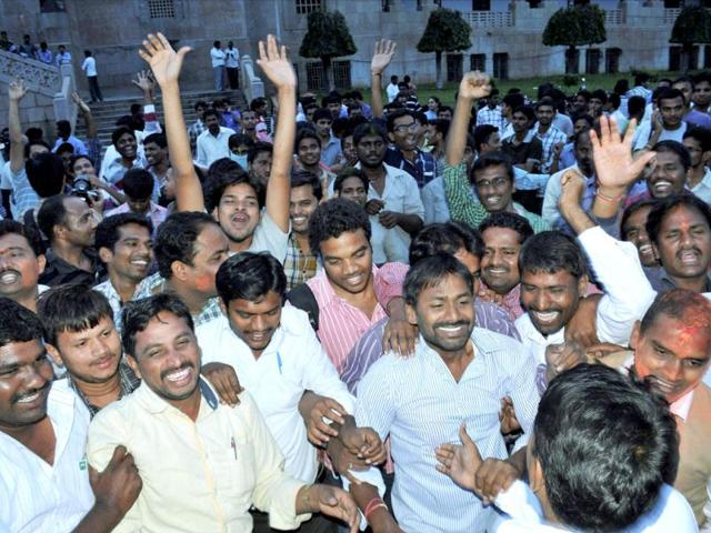 Pro-Telangana students celebrate at Osmania University in Hyderabad after Congress Working Committee endorsed a decision to create separate Telangana state. (PTI Photo)