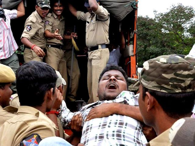 Police-arrest-protesters-during-a-protest-against-the-creation-of-separate-Telangana-state-in-Vishakhapatnam-PTI-Photo