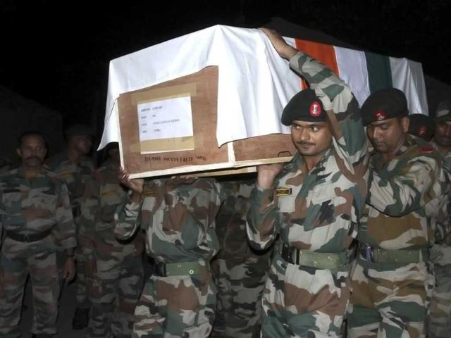 Army-soldiers-carry-the-coffin-of-their-colleague-killed-in-an-attack-by-the-the-Pakistani-troops-during-a-wreath-laying-ceremony-in-Poonch-Reuters