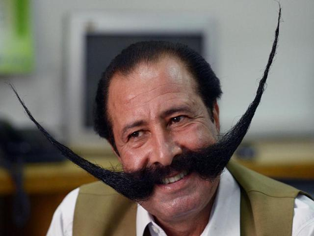 Impeccably-trimmed-to-30-inches-76-cms-Afridi-spends-30-minutes-a-day-washing-combing-oiling-and-twirling-his-moustache-into-two-arches-that-reach-to-his-forehead-defying-gravity-AFP-photo