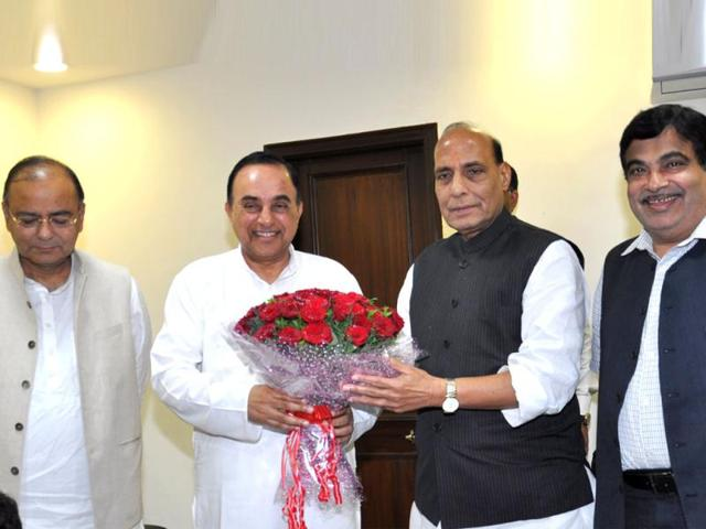 Janata-Party-president-Subramanian-Swamy-who-merged-his-party-with-the-BJP-is-seen-with-BJP-party-chief-Rajnath-Singh-HT-photo