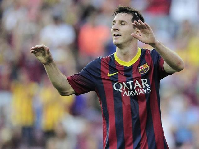 Messi brace lifts Barca back to the summit