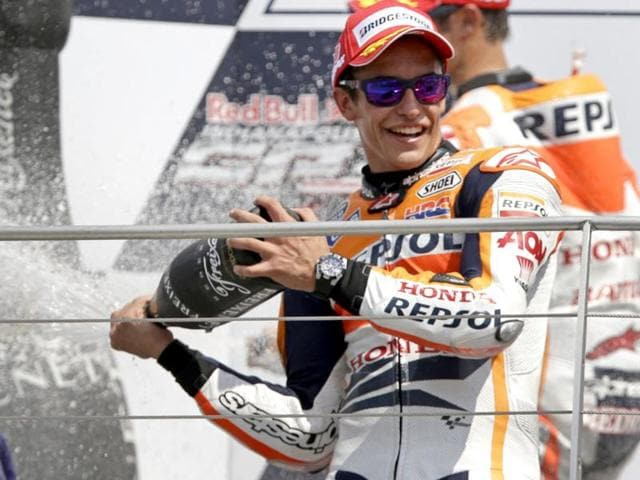 Marc-Marquez-celebrates-after-winning-the-Indianapolis-Grand-Prix-MotoGP-at-the-Indianapolis-Motor-Speedway-in-Indianapolis-AP