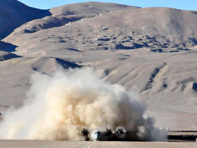 An-IAF-Lockheed-Martin-C-130J-Super-Hercules-kicks-up-a-cloud-of-dust-after-landing-at-the-high-altitude-Daulat-Beg-Oldie-military-airstrip-in-Ladakh-AFP-Photo
