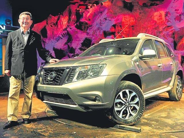 Nissan-India-president-Kenichiro-Yomura-poses-with-the-Terrano-SUV-in-Mumbai-on-Tuesday-Photo-AFP