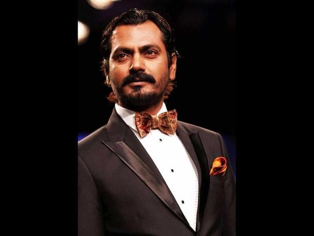 We-also-caught-the-shy-Nawazuddin-Siddiqui-quietly-sneaking-away-from-the-limelight-Photos-Yogen-Shah