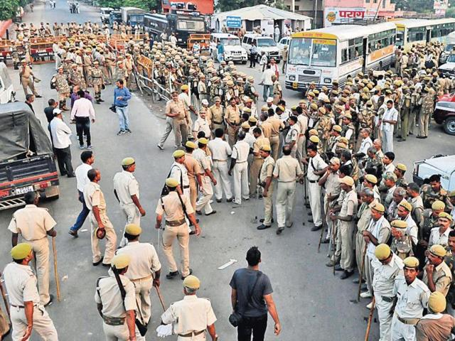 Police-personnel-guard-the-route-leading-to-the-Naya-Ghat-from-where-the-VHP-had-announced-its-plans-to-take-out-a-foot-march-in-Ayodhya-on-Sunday-HT-Photo