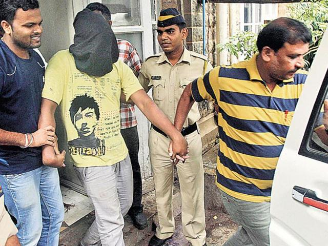 Police-escort-Mohamed-Kasim-Hafiz-Sheikh-alias-Bangali-prime-accused-in-the-gang-rape-after-producing-him-before-a-court-AP-Photo