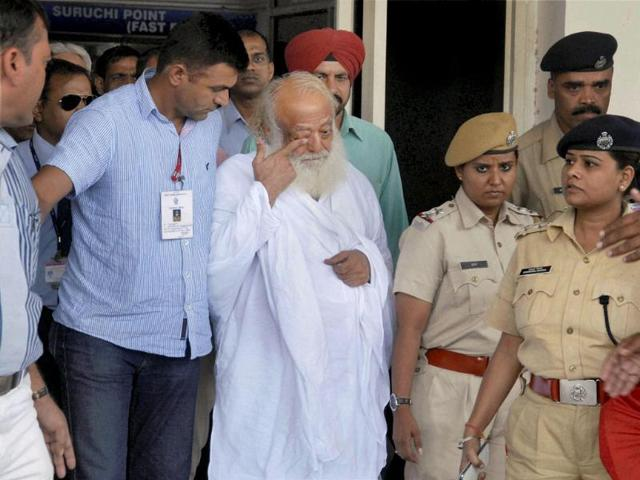 Asaram-after-being-arrested-from-his-Indore-ashram-by-Jodhpur-Police-arrives-at-Jodhpur-airport-on-Sunday-PTI-Photo
