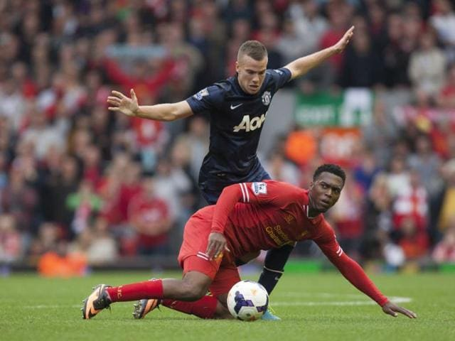 Liverpool-s-Daniel-Sturridge-fights-for-the-ball-against-Manchester-United-s-Tom-Cleverley-during-their-English-Premier-League-match-at-Anfield-Stadium-AP-Photo