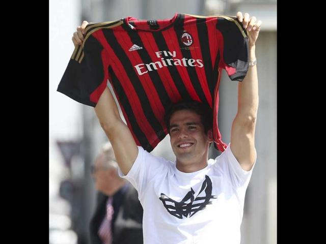 AC-Milan-player-Ricardo-Kaka-of-Brazil-holds-up-the-Milan-jersey-upon-his-arrival-at-the-Linate-airport-in-Milan-AP-Photo