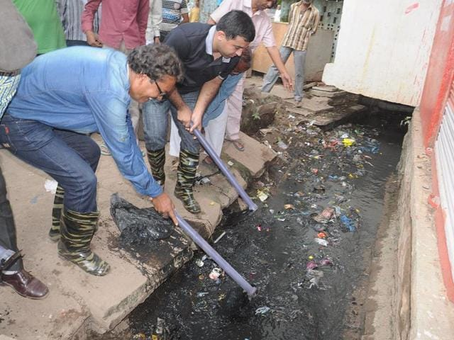 IAS-officer-and-Neemuch-collector-Vikas-Singh-Narwal-who-took-up-the-initiative-to-clean-the-clogged-drains-of-Moolchand-Marg-and-Ekta-Colony-himself-HT-Photo