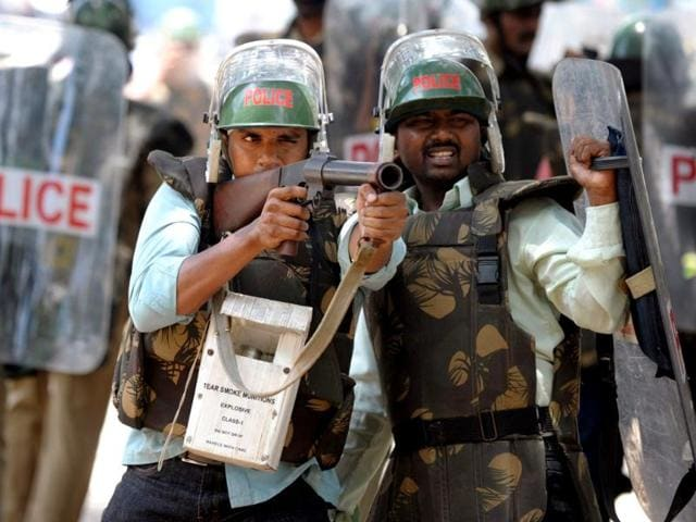 Police-confront-supporters-of-united-Andhra-Pradesh-during-a-protest-against-the-formation-of-Telangana-state-in-Kurnool-district-some-200-kms-from-Hyderabad-AFP-Photo