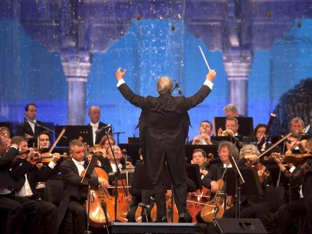 Orchestra conductor Zubin Mehta conducts the Bavarian State Orchestra, during the Ehsaas-e-Kashmir (Feelings for Kashmir) concert at Shalimar Garden on the outskirts of Srinagar. (AP Photo)