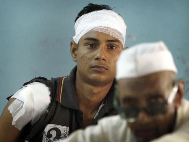 An unidentified man injured in communal clashes watches as he receives treatment at a district hospital in Muzaffarnagar, about 125 kilometers (78 miles) north of New Delhi. (AP Photo)
