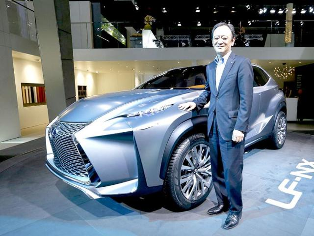 Tokuo Fukuichi, executive vice president of Lexus, poses next to a Lexus LF-NX mid-size crossover concept during a media preview day at the Frankfurt Motor Show (IAA). (Reuters Photo)