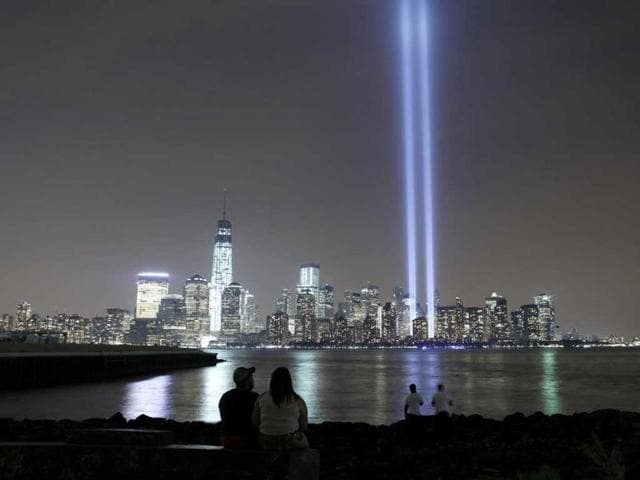 The-Tribute-in-Light-is-illuminated-next-to-One-World-Trade-Center-as-people-look-across-the-Hudson-River-in-Jersey-City-New-Jersey-September-11-2013-Reuters-Photo